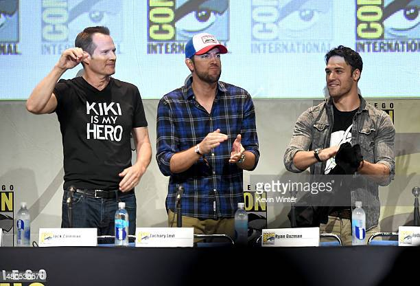Actors Jack Coleman Zachary Levi and Ryan Guzman applaud onstage at the 'Heroes Reborn' exclusive extended trailer and panel during ComicCon...
