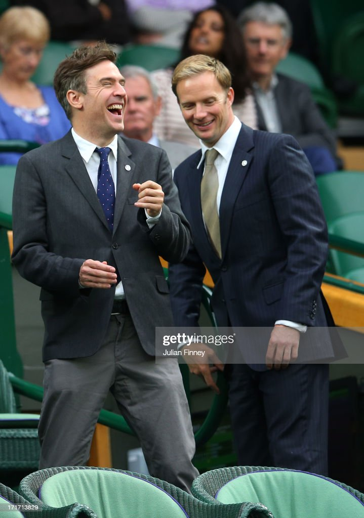 Actors Jack Davenport and Rupert PenryJones speak as they enter the Royal Box on Cenre Court on day five of the Wimbledon Lawn Tennis Championships...