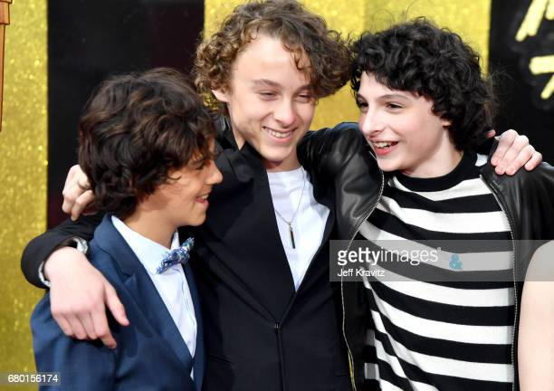 Actors Jack Dylan Grazer Wyatt Oleff and Finn Wolfhard attend the 2017 MTV Movie And TV Awards at The Shrine Auditorium on May 7 2017 in Los Angeles...