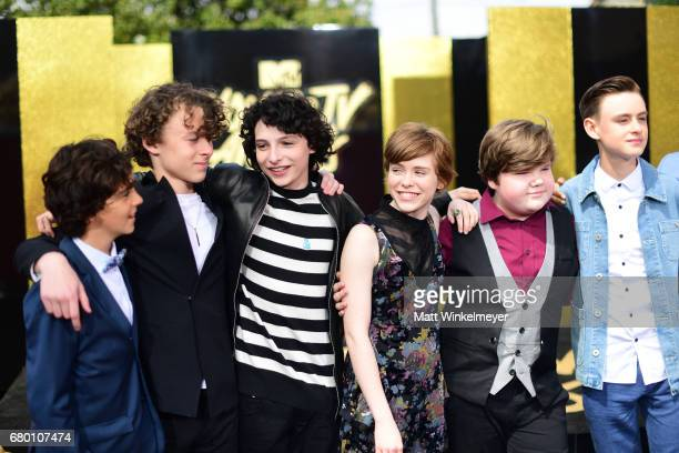 Actors Jack Dylan Grazer Wyatt Oleff Finn Wolfhard Sophia Lillis and Jeremy Ray Taylor attend the 2017 MTV Movie And TV Awards at The Shrine...