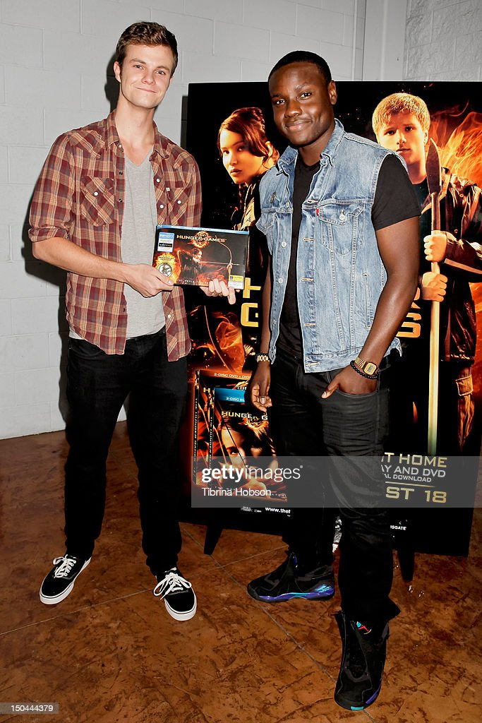 Actors Jack Quaid and Dayo Okeniyi attend Lionsgate's 'The Hunger Games' blu-ray disc and DVD release and fan signing at Walmart on August 17, 2012 in Santa Clarita, California.