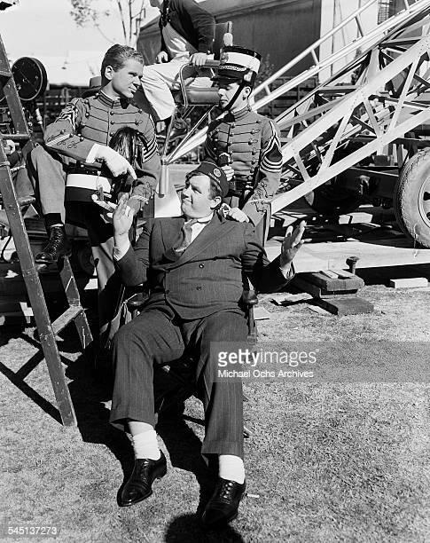 Actors Jackie Cooper Andy Devine Freddie Bartholomew pose on the set of 'Spirit of Culver' in Los Angeles California