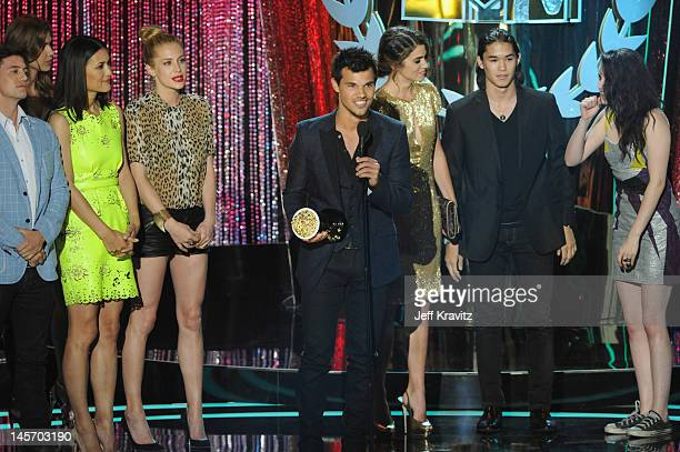 Actors Jackson Rathbone Julia Jones Taylor Lautner Nikki Reed Booboo Stewart and Kristen Stewart speak onstage at the 2012 MTV Movie Awards at Gibson...