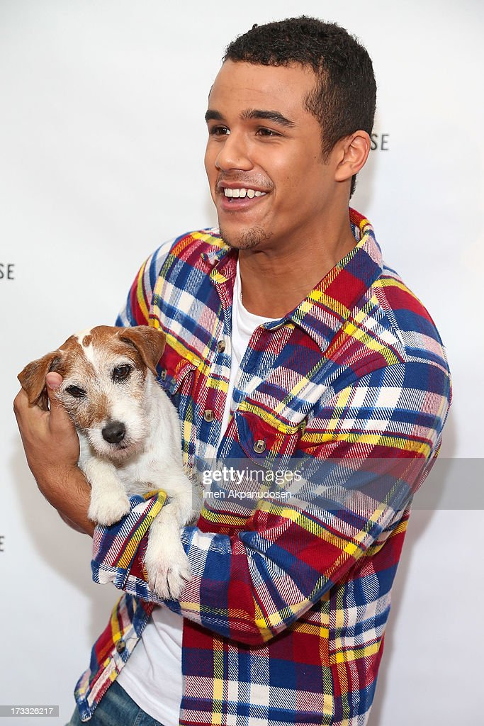 Actors Jacob Artist (R) and Uggie attend Abercrombie & Fitch's presentation of their 2013 Stars on the Rise at The Grove on July 11, 2013 in Los Angeles, California.