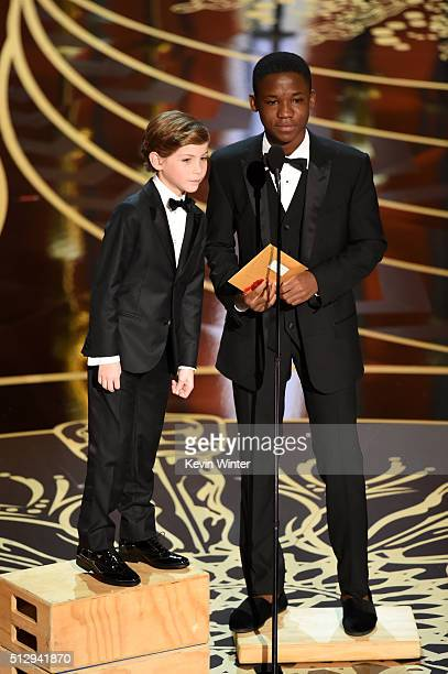 Actors Jacob Tremblay and Abraham Attah speak onstage during the 88th Annual Academy Awards at the Dolby Theatre on February 28 2016 in Hollywood...