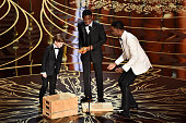 Actors Jacob Tremblay and Abraham Attah with host Chris Rock onstage during the 88th Annual Academy Awards at the Dolby Theatre on February 28 2016...