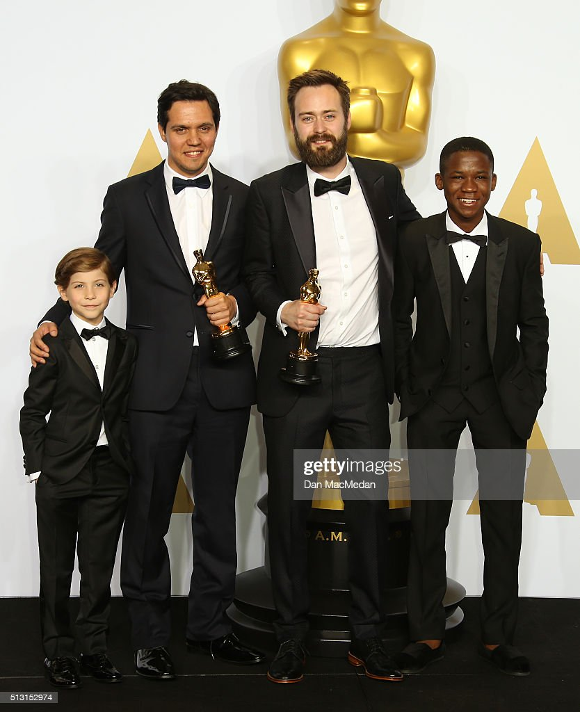 Actors Jacob Trembly Abraham Attah and Shan Christopher Ogilvy and Benjamin Cleary winners for Best Live Action short Film for 'Stutterer' pose in...