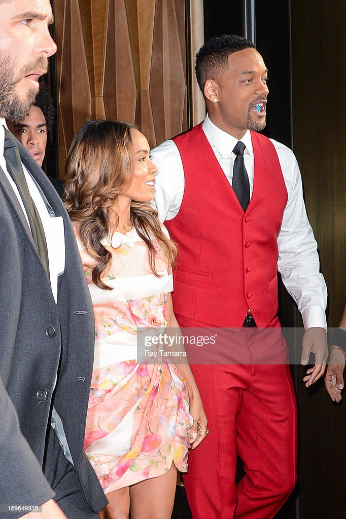 Actors Jada Pinkett Smith (L) and Will Smith leave their Soho hotel on May 29, 2013 in New York City.