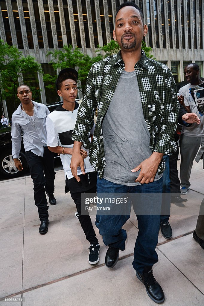 Actors Jaden Smith (L) and Will Smith enter the Sirius XM Studios on May 30, 2013 in New York City.