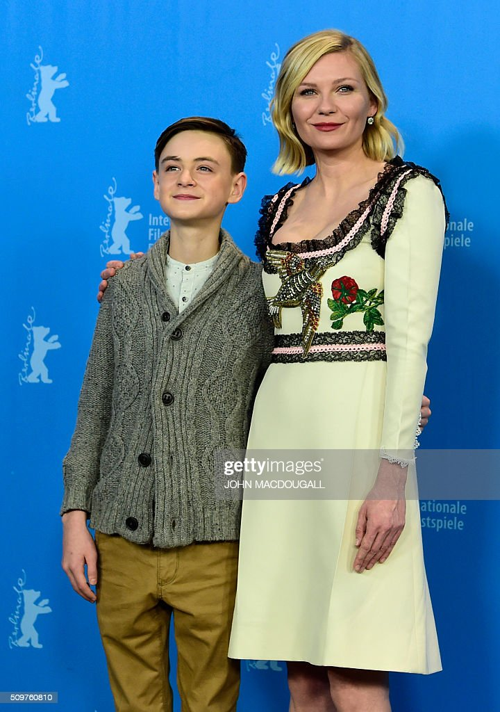 US actors (L-R) Jaeden Lieberher and Kirsten Dunst pose during a photocall for the film 'Midnight Special' presented at the Berlinale Film Festival in Berlin on February 12, 2016. Eighteen pictures will vie for the Golden Bear top prize at the event which runs from February 11 to 21, 2016. / AFP / John MACDOUGALL