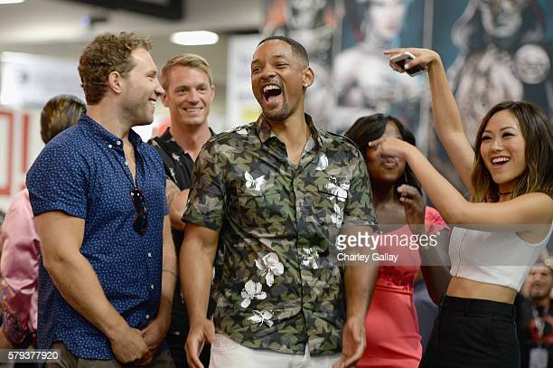 Actors Jai Courtney Joel Kinnaman Will Smith and Karen Fukuhara from the cast of Suicide Squad film participate in an autograph session for fans in...
