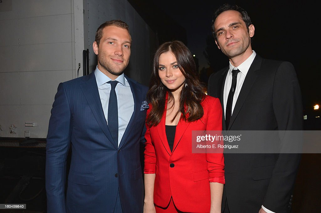 Actors Jai Courtney, Julia Snigir and Rasha Bukvic attend the dedication and unveiling of a new soundstage mural celebrating 25 years of 'Die Hard' at Fox Studio Lot on January 31, 2013 in Century City, California.