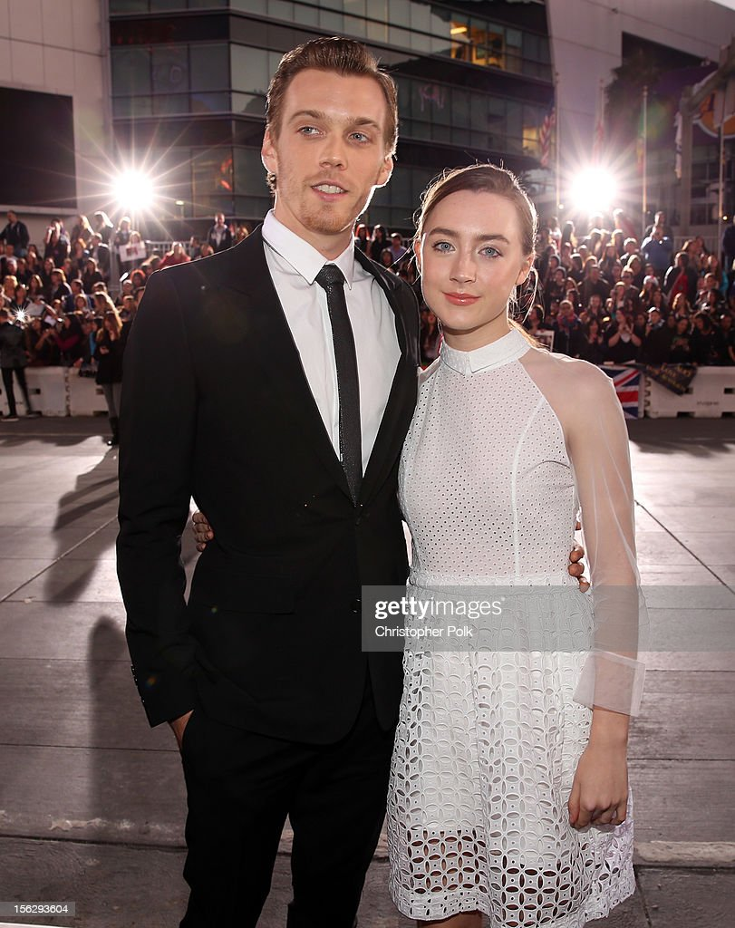 Actors Jake Abel (L) and Saoirse Ronan arrive at the premiere of Summit Entertainment's 'The Twilight Saga: Breaking Dawn - Part 2' at Nokia Theatre L.A. Live on November 12, 2012 in Los Angeles, California.