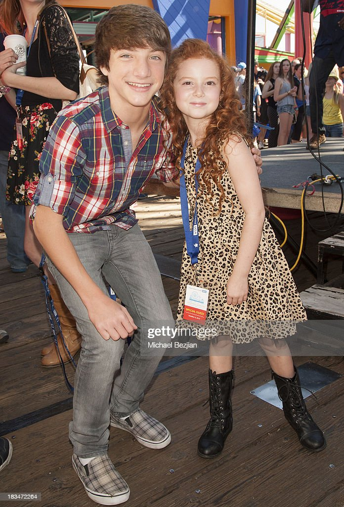 Actors Jake Short and Francesca Capaldi volunteer at the 14th Annual 'Mattel Party On The Pier' Benefiting Mattel Children's Hospital UCLA at Santa Monica Pier on October 6, 2013 in Santa Monica, California.
