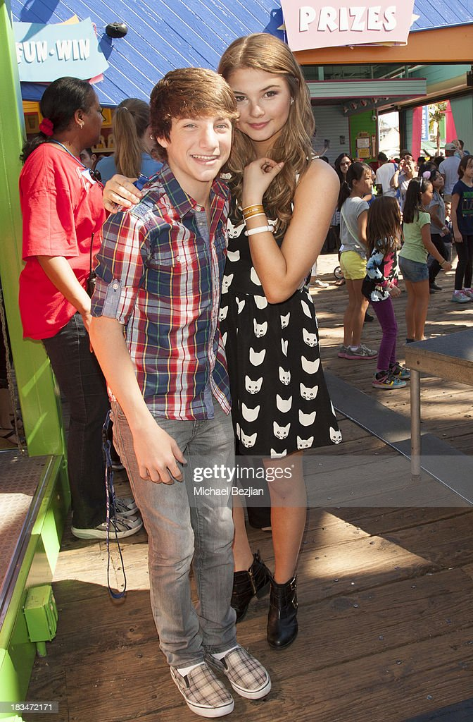 Actors Jake Short and <a gi-track='captionPersonalityLinkClicked' href=/galleries/search?phrase=Stefanie+Scott&family=editorial&specificpeople=5781540 ng-click='$event.stopPropagation()'>Stefanie Scott</a> volunteer at the 14th Annual 'Mattel Party On The Pier' Benefiting Mattel Children's Hospital UCLA at Santa Monica Pier on October 6, 2013 in Santa Monica, California.