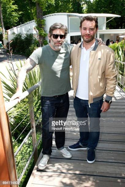 Actors Jalil Lespert and his brother Yaniss Lespert attend the 2017 French Tennis Open Day Thirteen at Roland Garros on June 9 2017 in Paris France