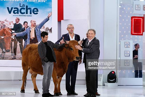 Actors Jamel Debbouze Lambert Wilson Fatsah Bouyahmed Presenter of the show Michel Drucker and a cow present the Movie 'La Vache' during the...