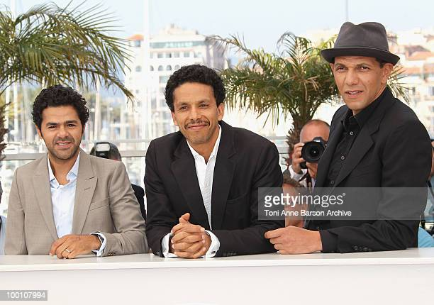 Actors Jamel Debbouze Sami Bouajila and Roschdy Zem attend the 'Outside the Law' Photo Call held at the Palais des Festivals during the 63rd Annual...
