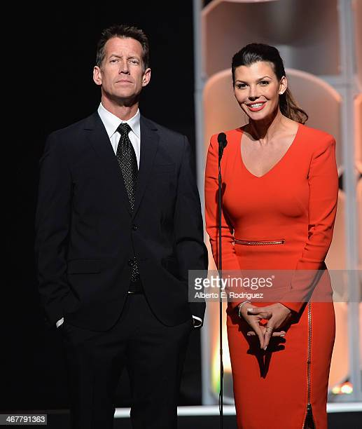 Actors James Denton and Ali Landry speak on stage at the 22nd Annual Movieguide Awards Gala at the Universal Hilton Hotel on February 7 2014 in...