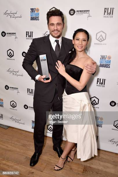 Actors James Franco and Lucy Liu pose with the Best Actor Award at The 2017 IFP Gotham Independent Film Awards cosponsored by FIJI Water at Cipriani...