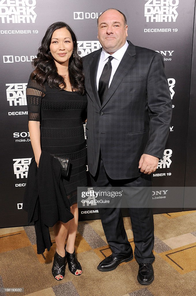 Actors James Gandolfini (R) and wife Deborah Lin arrive at the Los Angeles premiere of 'Zero Dark Thirty' at the Dolby Theatre on December 10, 2012 in Hollywood, California.