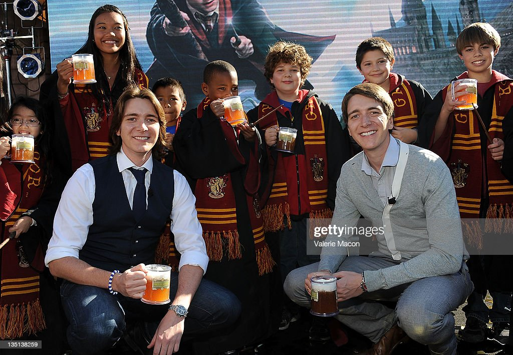 Actors James Phelps and Oliver Phelps attend Universal Studios Hollywood Hosts Butterbeer Toast at The Globe Theatre on December 6 2011 in Universal...