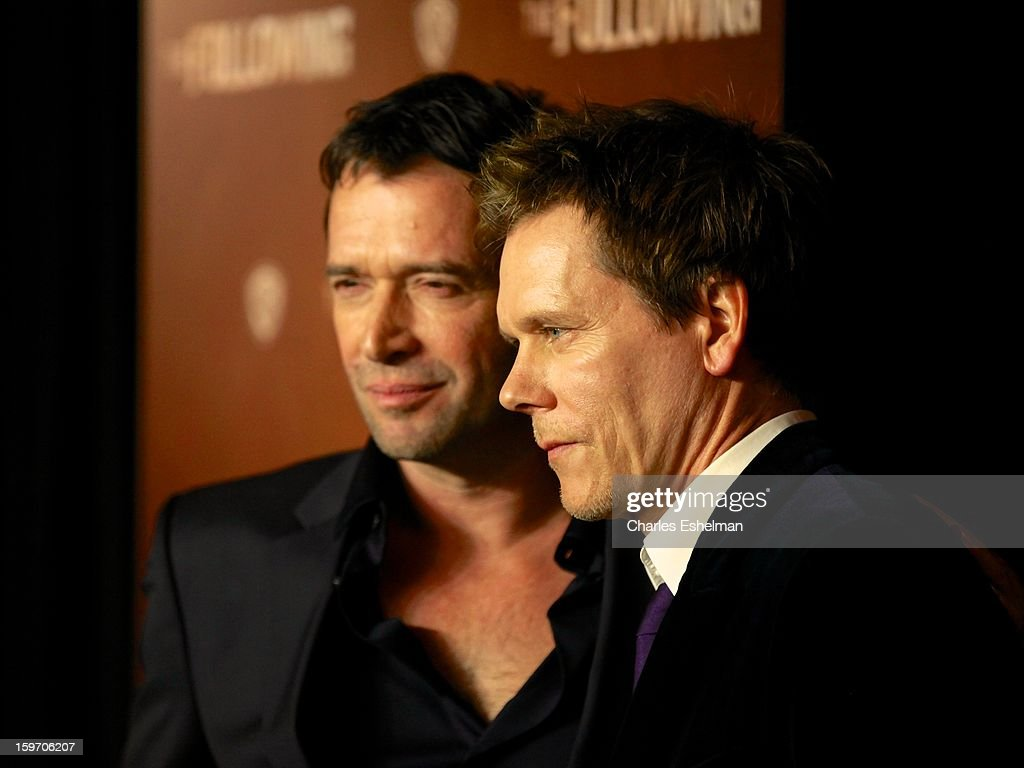 Actors James Purefoy and Kevin Bacon attend 'The Following' premiere at The New York Public Library on January 18, 2013 in New York City.