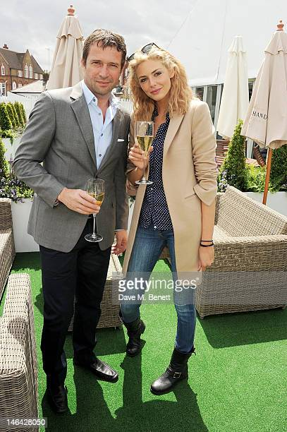 Actors James Purefoy and Tamsin Egerton attend the Moet Chandon suite at The Queen's Club Tennis Championships on June 16 2012 in London England