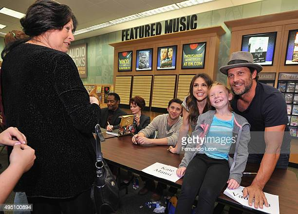 Actors James Reynolds and Patsy Pease sign books while their colleages Billy Flynn Kate Mansi and Greg Vaughan pose for pictures during the Days Of...