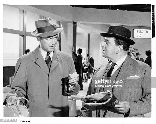 Actors James Stewart and Robert Morley talk in a scene from the movie 'Take Her She's Mine' circa 1963