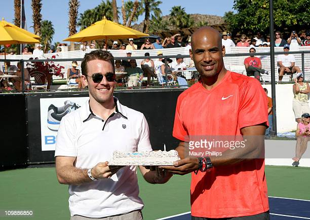 Actors James Van Der Beek and Boris Kodjoe receive a birthday cake in celebration of their joint birthdays during the 7th Annual KSwiss Desert Smash...