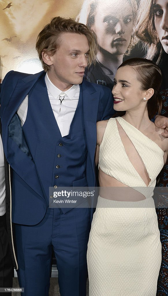 Actors <a gi-track='captionPersonalityLinkClicked' href=/galleries/search?phrase=Jamie+Campbell+Bower&family=editorial&specificpeople=4586724 ng-click='$event.stopPropagation()'>Jamie Campbell Bower</a> and <a gi-track='captionPersonalityLinkClicked' href=/galleries/search?phrase=Lily+Collins&family=editorial&specificpeople=3520243 ng-click='$event.stopPropagation()'>Lily Collins</a> attend the premiere of Screen Gems & Constantin Films' 'The Mortal Instruments: City of Bones' at ArcLight Cinemas Cinerama Dome on August 12, 2013 in Hollywood, California.