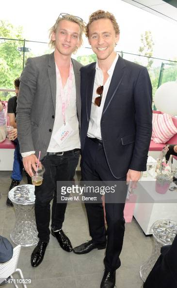 Actors Jamie Campbell Bower and Tom Hiddleston attend the evian 'Live young' VIP Suite at Wimbledon on June 25 2012 in London England