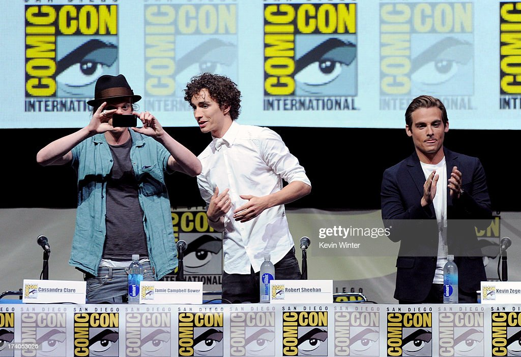 Actors Jamie Campbell Bower, Robert Sheehan, and Kevin Zegers speaks onstage at the Sony and Screen Gems panel for 'The Mortal Instruments: City of Bones' during Comic-Con International 2013 at San Diego Convention Center on July 19, 2013 in San Diego, California.