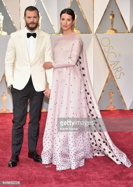 Actors Jamie Dornan and Amelia Warner attend the 89th Annual Academy Awards at Hollywood Highland Center on February 26 2017 in Hollywood California