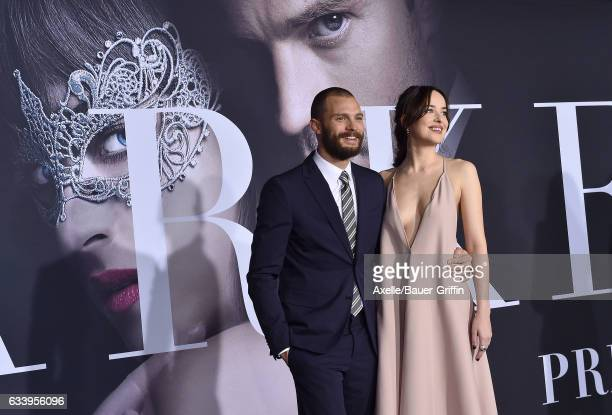 Actors Jamie Dornan and Dakota Johnson arrive at the premiere of Universal Pictures' 'Fifty Shades Darker' at The Theatre at Ace Hotel on February 2...