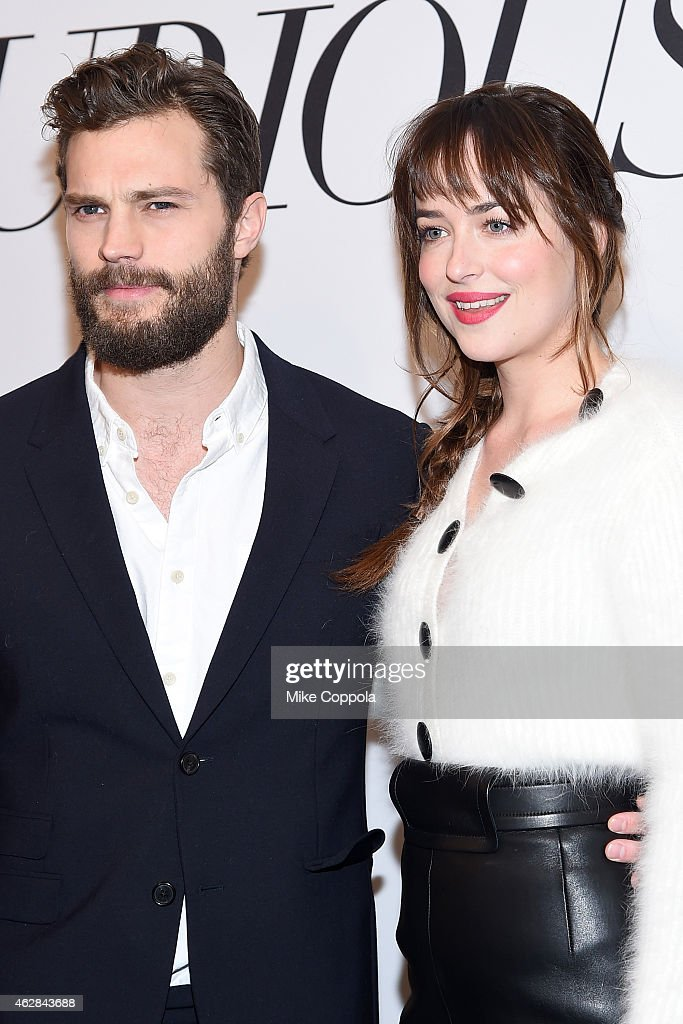 Actors Jamie Dornan and Dakota Johnson attend the 'Fifty Shades Of Grey' New York Fan First screening at Ziegfeld Theatre on February 6 2015 in New...