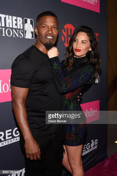 Actors Jamie Foxx and Olivia Munn arrive on TMobile's magenta carpet duirng the Showtime WME IME and Mayweather Promotions VIP PreFight Party for...