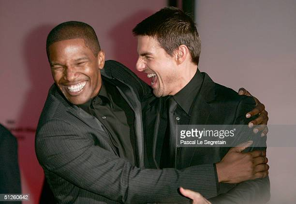 Actors Jamie Foxx and Tom Cruise attend the 'Collateral' Premiere at the 61st Venice Film Festival on September 3 2004 in Venice Italy