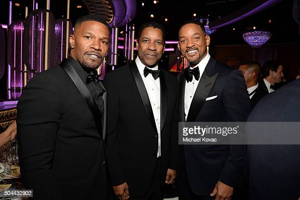 Actors Jamie Foxx Denzel Washington and Will Smith attend the 73rd Annual Golden Globe Awards held at the Beverly Hilton Hotel on January 10 2016 in...