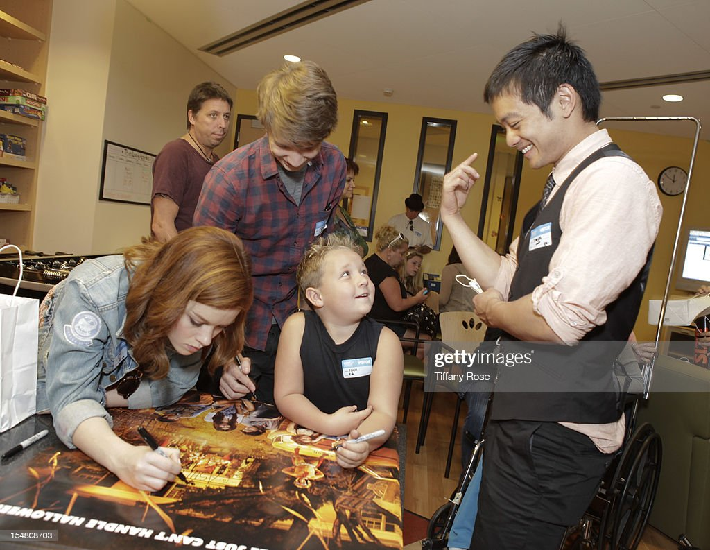 Actors Jane Levy Thomas Mann Jackson Nicoll and Osric Chau sign autographs at 'Fun Size' Special Screening At Children's Hospital Los Angeles at...