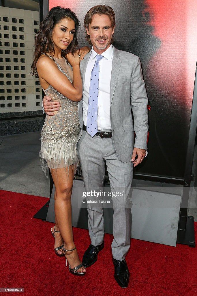 Actors Janina Gavankar (L) and Sam Trammell arrive at HBO's 'True Blood' season 6 premiere at ArcLight Cinemas Cinerama Dome on June 11, 2013 in Hollywood, California.