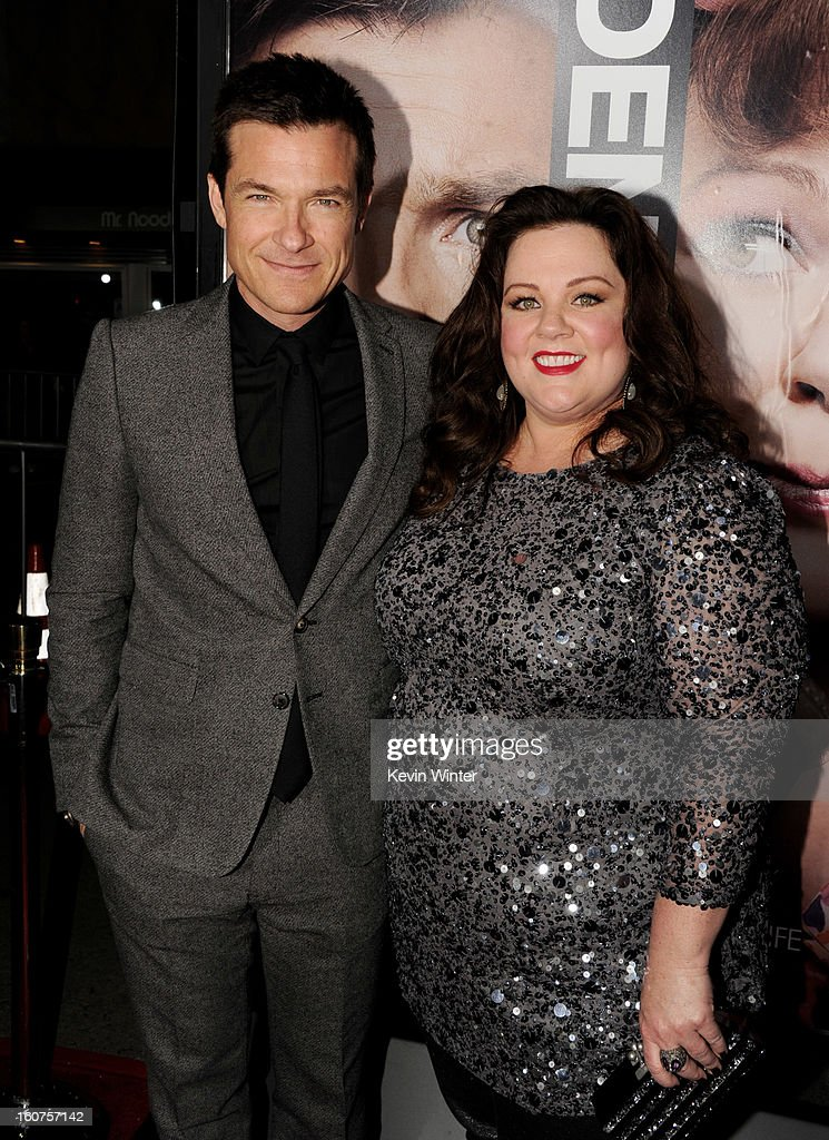 Actors Jason Bateman (L) and Melissa McCarthy arrive at the premiere of Universal Pictures' 'Identity Thief' at the Village Theatre on February 4, 2013 in Los Angeles, California.