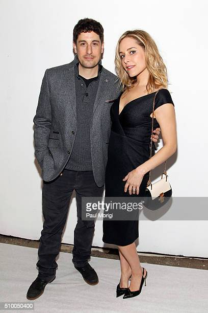 Actors Jason Biggs and Jenny Mollen pose backstage at the Christian Siriano Fall 2016 fashion show during New York Fashion Week at ArtBeam on...
