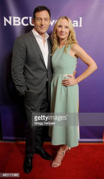 Actors Jason Isaacs and Anne Heche arrive at the 2014 Television Critics Association Summer Press Tour NBCUniversal Day 2 at The Beverly Hilton Hotel...