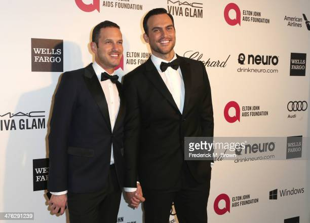 Actors Jason Landau and Cheyenne Jackson attend the 22nd Annual Elton John AIDS Foundation's Oscar Viewing Party on March 2 2014 in Los Angeles...
