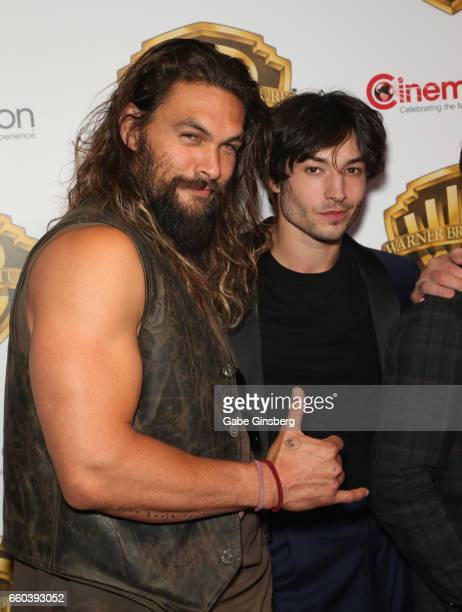 Actors Jason Momoa and Ezra Miller attend the Warner Bros Pictures presentation during CinemaCon at The Colosseum at Caesars Palace on March 29 2017...