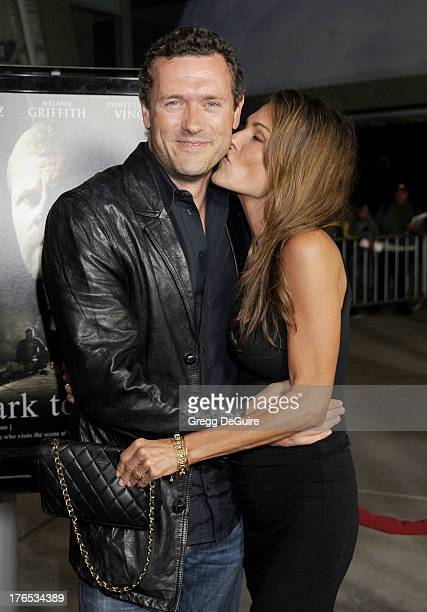 Actors Jason O'Mara and Paige Turco arrive at the Los Angeles premiere of 'Dark Tourist' at ArcLight Hollywood on August 14 2013 in Hollywood...