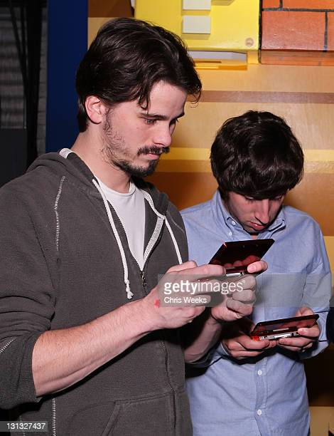 Actors Jason Ritter and Simon Helberg attend Nintendo's celebration of the launch of Super Mario 3D Land at Siren Studios on November 3 2011 in...