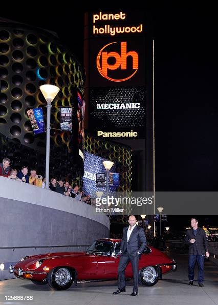 Actors Jason Statham and Jason Flemyng arrive at a screening of CBS Films' 'The Mechanic' in a 1970 EType Series 2 Jaguar coupe at the Planet...